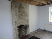 Stripped out sitting room, decontaminated and ready for re-build.